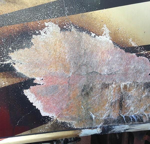 Close up image of damaged fiberglass