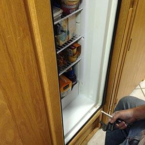 Image of Richard preparing to replace the door
